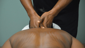 Hands massaging back and neck.