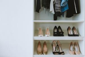 Shoes organized in closet on shelves