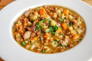 Lentil soup with meat and a variety of veggies.