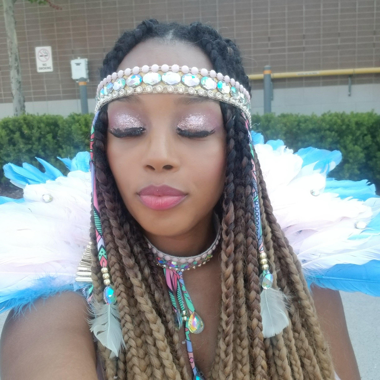 Masquerader dressed in backline costume at 2019 Caribana in Toronto Canada