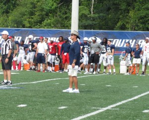 Head Coach Joey Jones observes the Jags first scrimmage of preseason camp on Saturday, August 10, 2013.