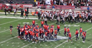 South Alabama gathers at midfield as they enter the field.