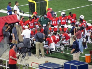 First year defensive coordinator Kevin Sherrer talks with the defense on the sidelines at Ladd-Peebles Stadium in the Jaguars season opener against Southern Utah on Thursday night.