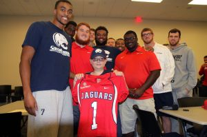 Colby Sawyer with South Alabama student-athletes during his visit with coach Jones and and the team prior to the Monday press conference. | Photo: al.com usajaguars.com