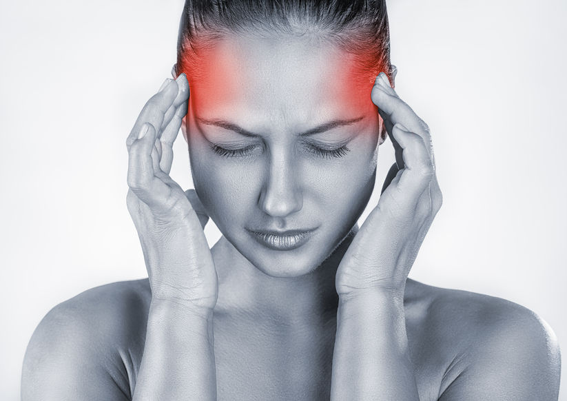 woman with headache isolated on white background