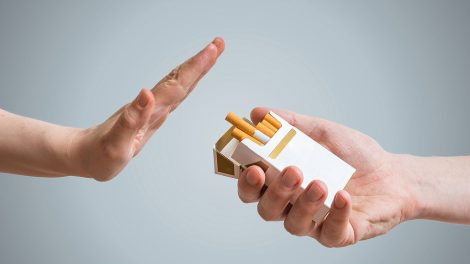 Quitting smoking concept. Hand is refusing cigarette offer.