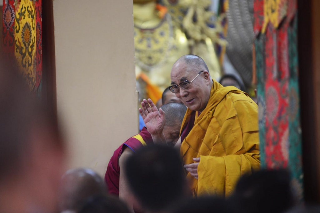 The Dalai Lama greets his followers ahead of a teaching session at ...
