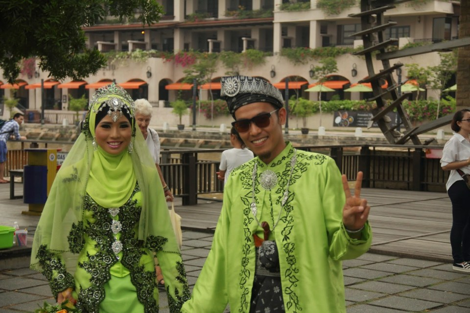 Malay bride and groom getting a photoshoot at Melaka