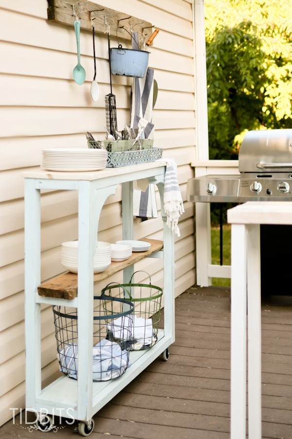 Outdoor grill area and rolling cart serving station.  Deck makeover by TIDBITS.