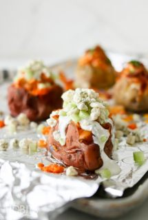 Pressure Cooker Buffalo Chicken Stuffed Potatoes
