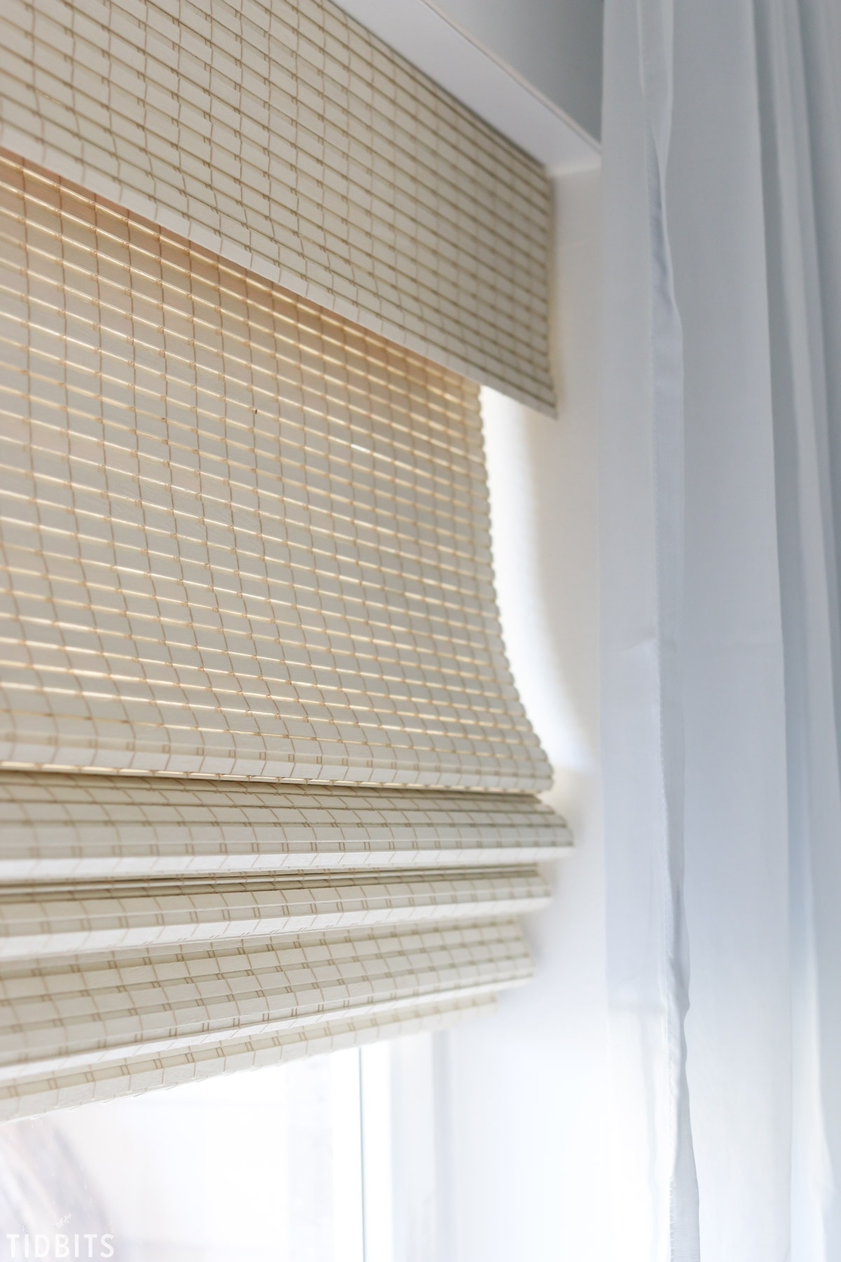 Our beautiful natural woven shades for our home office.