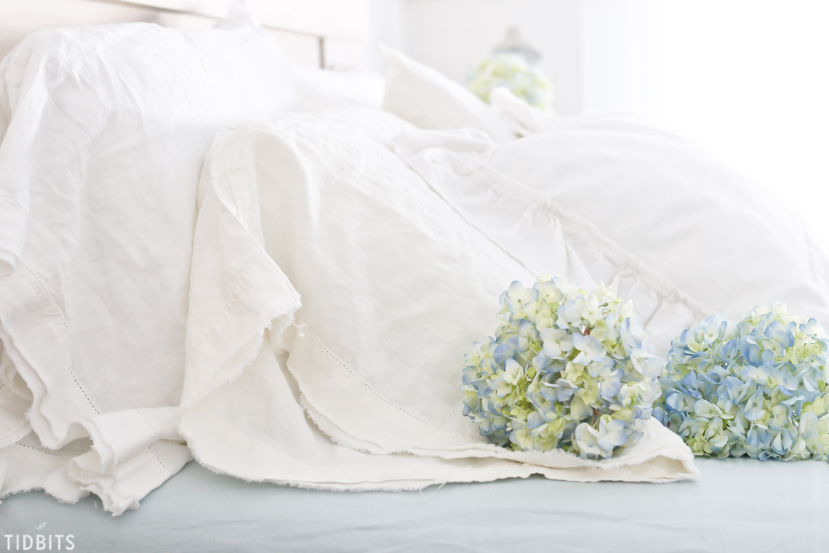 soft blue hydrangeas and linen sheets