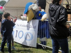 Haydon the Womble high-fives the kids