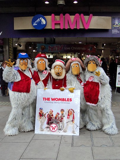 The Wombles outside HMV with the Wombling Merry Christmas CD cover
