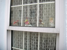Wombles in the window of Elisabeth Beresford's house