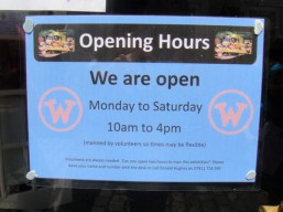 Opening hours sign for the exhibition
