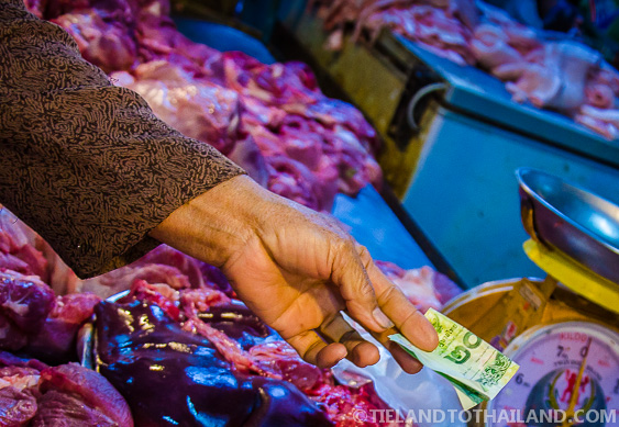 Paying For Meat at the Thai Food Market