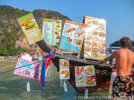 Longtail boats selling food and adult beverages in Ao Nang, Thailand