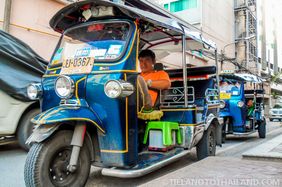 A tuk tuk driver waiting for a customer