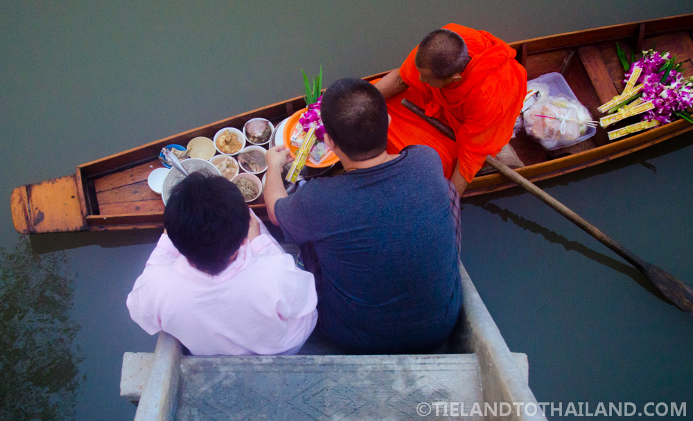 Alms to monks at Baan Suan Krua Homestay