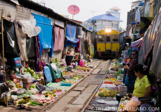 Enter the train at the Maeklong Railway Market