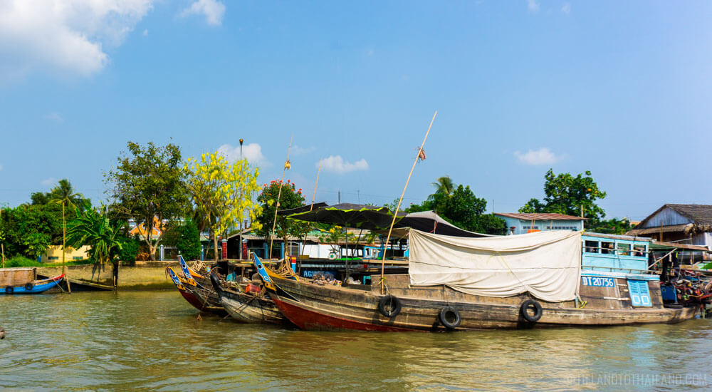 Yams for sale! Sampan boats selling goods in the Mekong River
