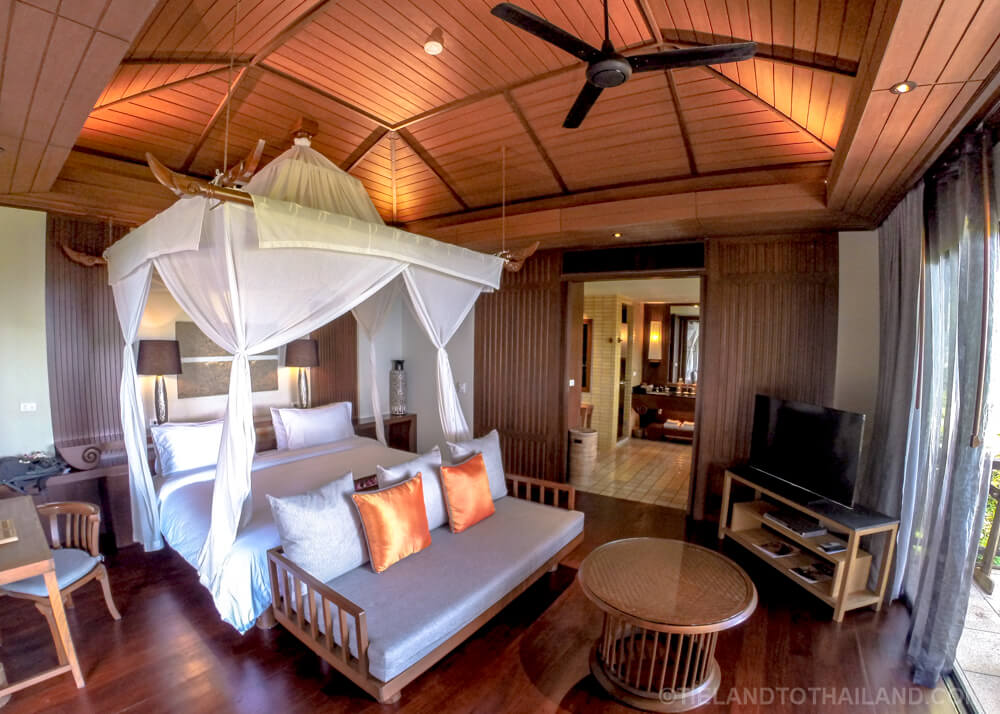 Romantic bedroom with canopy bed and sea views