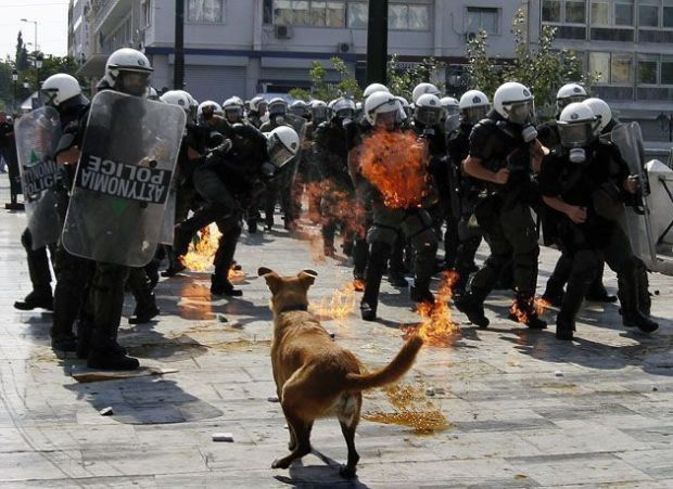 Policemen avoid petrol bomb during protest in Athens