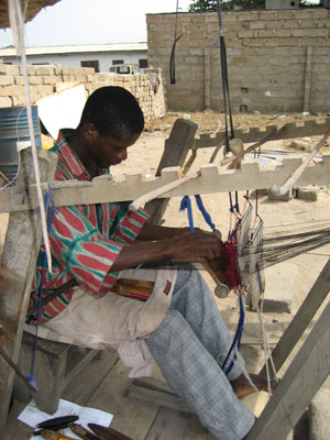 Eddie the weaver weaving in Ghana