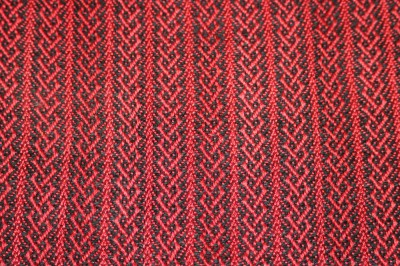 Closeup of celtic knot weaving pattern for the handwoven cashmere coat