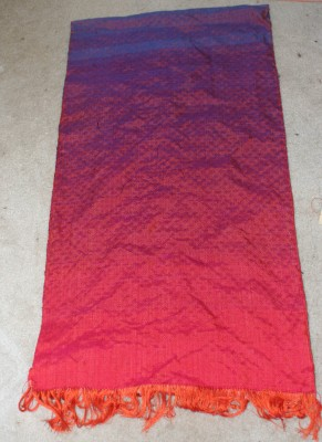 Full view of woven iridescence shawl