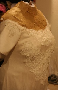 handwoven wedding dress with basted-on lace, three-quarter view