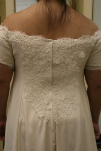 handwoven wedding dress, partially complete, closeup of back