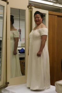handwoven wedding dress, partially complete, three-quarter view