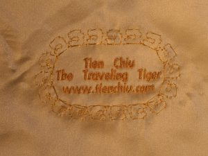 machine embroidered label for handwoven wedding dress