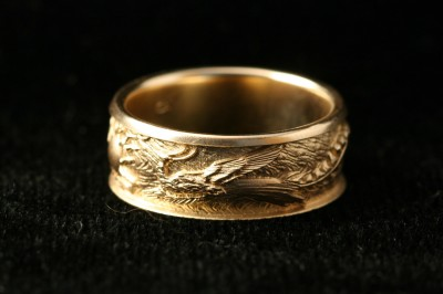 dragon phoenix ring, carved by Carol Mortensen