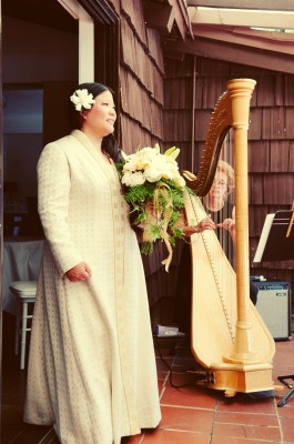 Tien with harpist