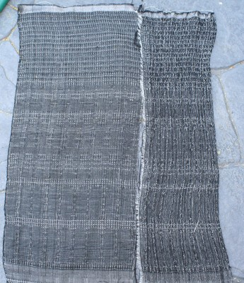 Plain weave and waffle weave, networked and allover pattern, with white overtwisted wool weft, beaten loosely.  Warp is black 60/2 silk sett at 40 epi.