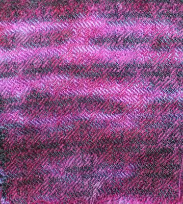 arashi shibori fiber-reactive dye in purple and black, followed by scrunch-dyeing in red/purple acid dye.  Complex weave pattern.