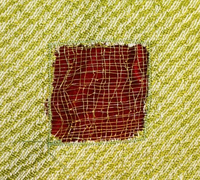 devore square, metallic gold thread against red velvet