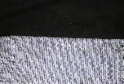 Celtic braid fabric against black leather