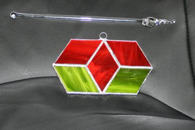 stained-glass piece and glass swizzle stick