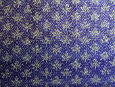 maple leaves, wool weft.  Top section has 1 gold machine embroidery thread laid in with every fourth shot of wool.