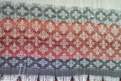 header with painted weft