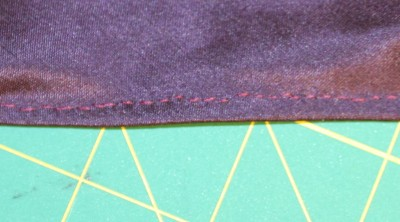 prick-stitched edge, on the private side