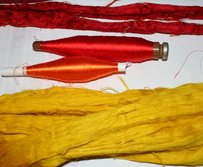 dyed silk, skeins and pirns