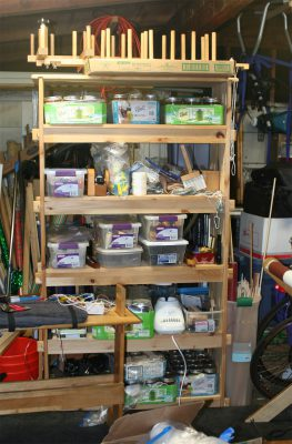 the shelf packed with weaving equipment