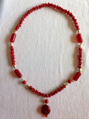 kumihimo necklace with hollow glass beads