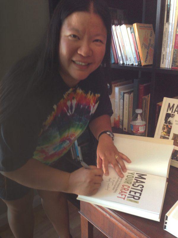 Tien signing books!