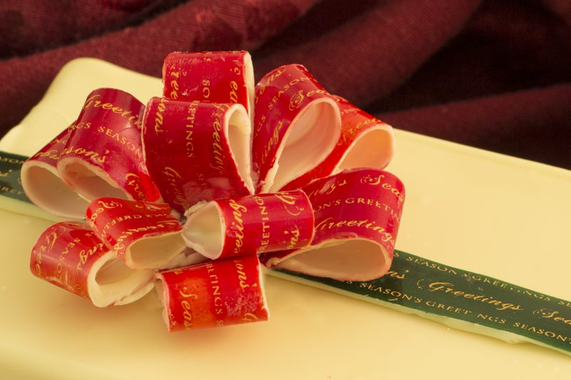 white-chocolate-box-with-red-bow-and-green-ribbon